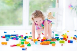 a toddler playing lego toys